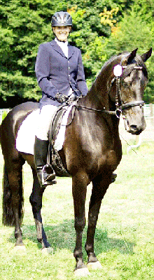 Dr. Christie on Tyberius, her Friesian/Arab cross